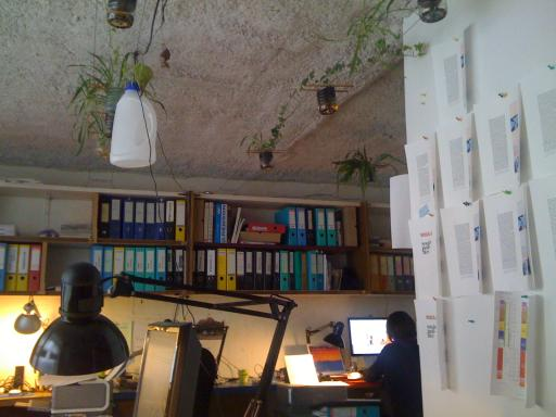The office of AAA in Paris, complete with recylced bottle lampshades.
